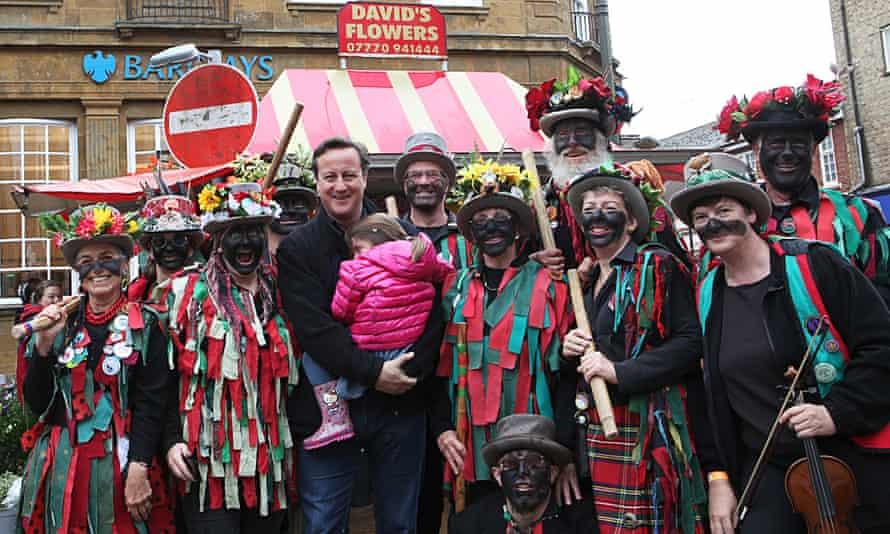 David Cameron poses with black-faced morris dancers