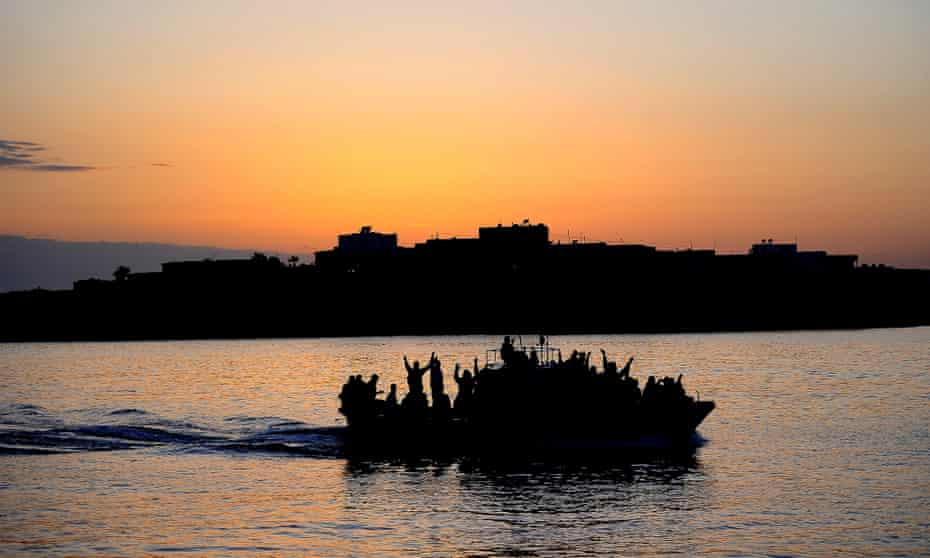 A boat carrying migrants enters the port of Lampedusa.