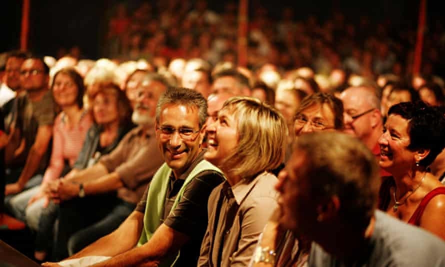 Audience watching a show in a small theatre