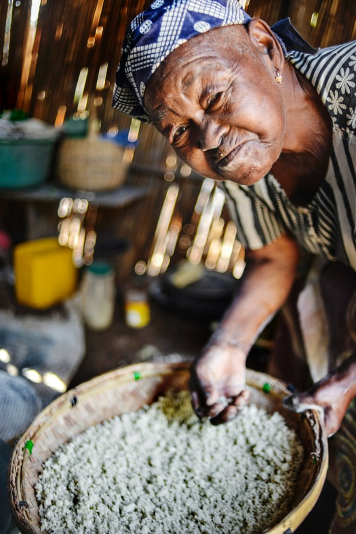 Angelina Tovele grinds cassava into flour