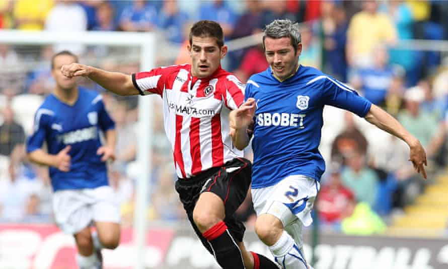 Sheffield United's Ched Evans challenges Cardiff's Kevin McNaughton