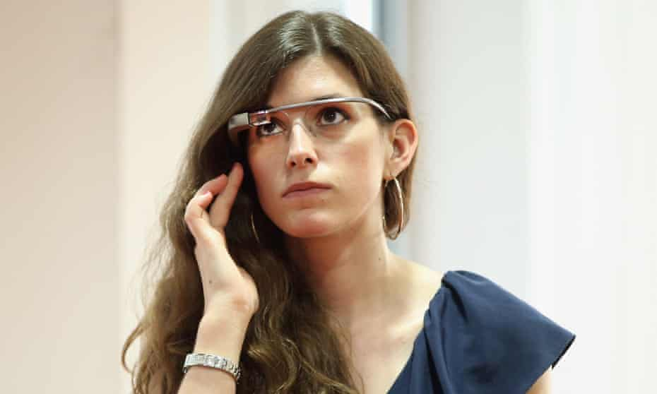 A young woman wearing Google Glass