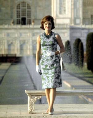 First Lady Jackie Kennedy standing on the grounds of the Taj Mahal.