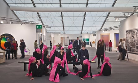 frieze ten people one hat pink ribbons
