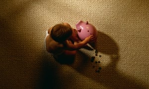 Child and piggy bank.