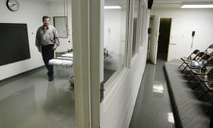 Terry Crenshaw, wardens assistant at the Oklahoma State Penitentiary, walks past the gurney in the execution chamber at left, in McAlester.