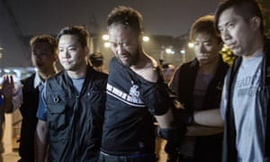 Ken Tsang, a Hong Kong pro-democracy activist, is taken away by police before they were filmed beating him in a side street.