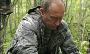 Vladimir Putin fits tracking device on tiger