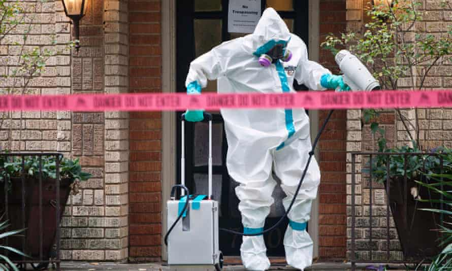 A HazMat worker disinfects the Dallas residence of a health worker at the Texas Health Presbyterian hospital who has contracted Ebola.
