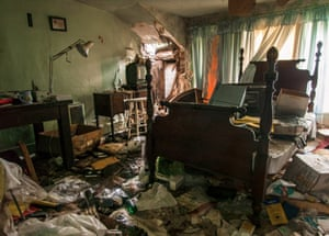A forgotten bedroom filled with furniture and rubbish