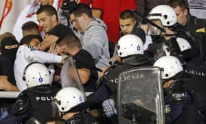 Riot police clash with fans during Serbia's Euro 2016 qualifier against Albania.
