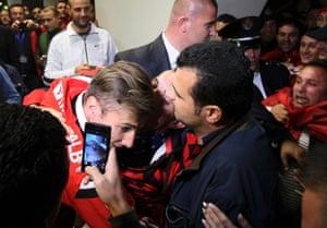 Albanian fans kiss and hug Albania captain Lorik Cana after the players return to Tirana