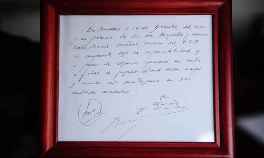 The framed napkin on which Lionel Messi's informal Barcelona contract was written by Carles Rexach in December 2000.