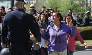 Occupant of an abandoned building shouts at a police officers during her eviction in Seville