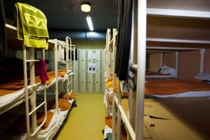 Women's dormitory with triple bunk metal beds
