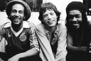 Bob Marley, Mick Jagger and Peter Tosh pose backstage at a Rolling Stones concert at the Palladium in New York, 19 June 1978