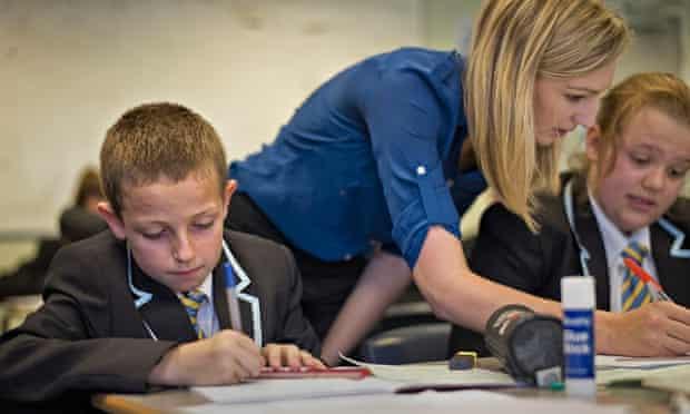 A teacher helps students at the Clacton Coaastal Academy.