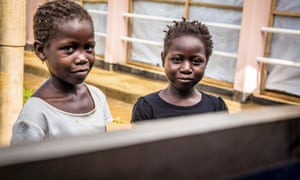Two children recovering from Ebola virus wait at a treatment centre in the Hastings area of Freetown, Sierra Leone.