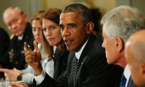 President Barack Obama speaks (3rd R) during a meeting with cabinet agencies coordinating the government's Ebola response.