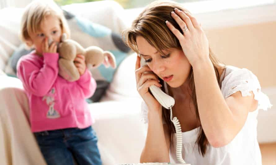 Woman on phone with child in background