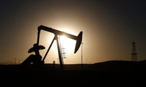A pump jack is seen at sunrise near Bakersfield, California October 14, 2014. Brent crude hit a new four-year low on Wednesday before recovering to just under $85 a barrel.