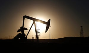 A pump jack is seen at sunrise near Bakersfield, California. Brent crude hit a new four-year low on Wednesday before recovering to just under $85 a barrel.
