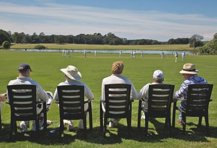A cricket match in front of Holkham Hall