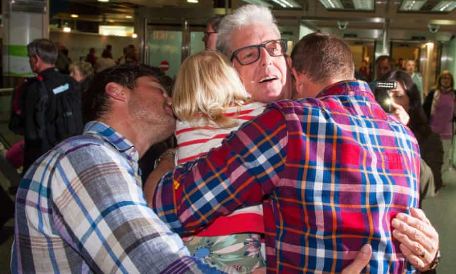 Ray Cole is greeted by his family at Gatwick airport.