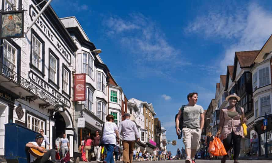 Shoppers on Guildford's historic high street.
