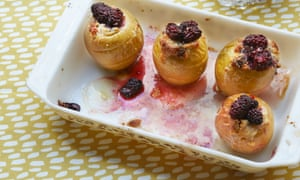 Serve the stuffed apples warm along with a few extra blackberries.