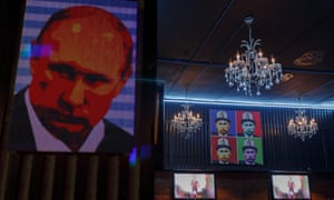 Putin paraphernalia covers the walls of the new Bishkek bar.