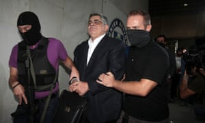 Golden Dawn leader Nikos Michaloliakos is escorted by anti-terror police in Athens