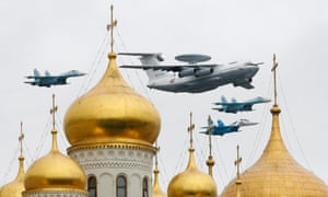 A Russian Air Force Beriev A-50 early warning aircraft flies with fighter jets over Red Square and the Kremlin during a military parade rehearsal in Moscow in 2010.