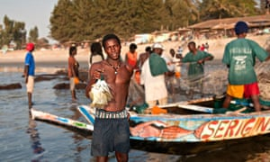 Fisherman at Kololi beach in the Gambia. Hoteliers in the area are concerned that Ebola fears are de