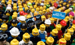 Lego figures fitted with protest banners, by Greenpeace activtists