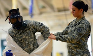 Pfc Kaiya Capuchino from US Army Medical Research Institute of Infectious Diseases trains US Army soldiers from the 101st Airborne Division who are earmarked for the fight against Ebola.