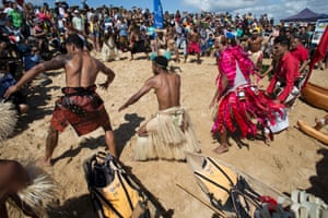 Protesters prepare to launch their vessels with traditional Polynesian war dances.