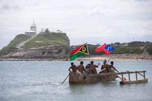Protesters from 12 Pacific Island nations in traditional vessels join activists in an attempt to block coal ships.