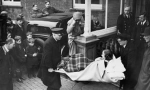 4 January 1940: Unity Valkyrie Mitford being carried on a stretcher from a hotel at Folkestone to a waiting ambulance.