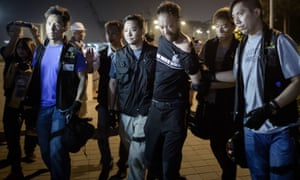 Civic Party member Ken Tsang, one of Hong Kong's pro-democracy political groups, is taken away by policemen, before being allegedly beaten up by police forces.