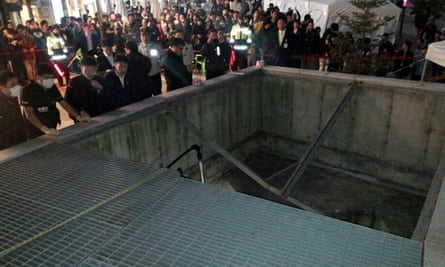 People gather around the collapsed ventilation grate at the venue in Seongnam, South Korea