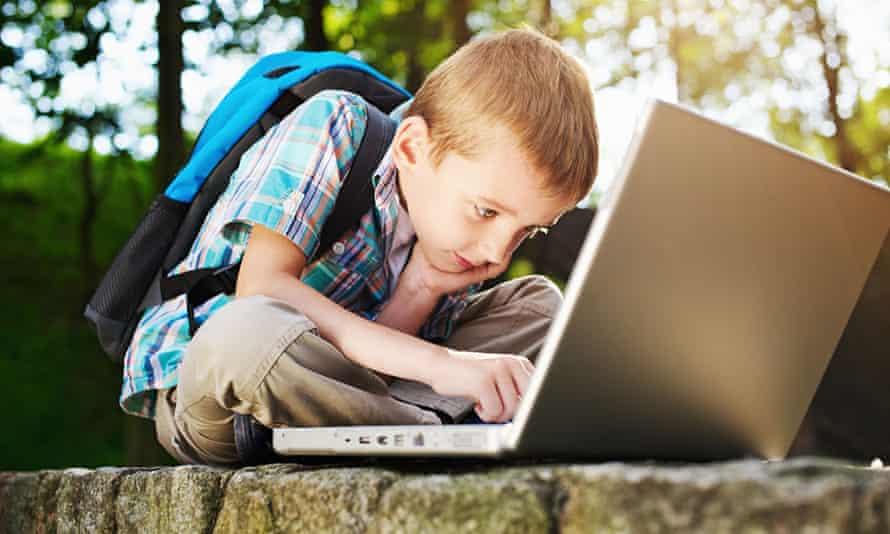 Boy focused on notebook