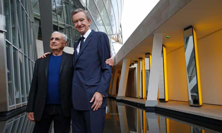 Frank Gehry (L) and Bernard Arnault inside the new building.
