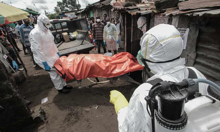 A burial team with the body of an Ebola victim in Monrovia, Liberia. Photograph: Marcus DiPaola/NurP