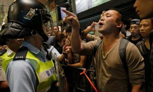 Riot police and protesters in the Mong Kok district of Hong Kong on Friday