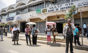People wait for a bus in Addis Ababa. The government has launched an ambitious modernisation plan in the Ethiopian capital.