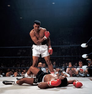 Muhammad Ali towering over Sonny Liston in their second fight in 1965 after Liston had dropped to the canvas following the so-called 'phantom punch'. The fight lasted just two minutes and eight seconds.