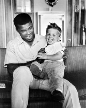 Muhammad Ali with Bob Gomel's son, Corey.