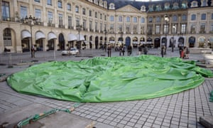 The deflated sculpture in Place Vendôme after vandals cut the cables holding it up.