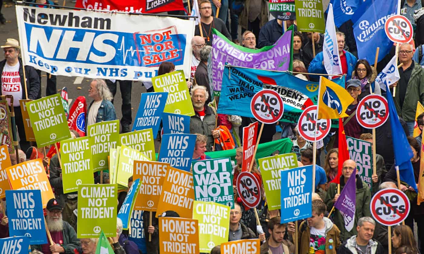 Tens of thousands take to UK streets in pay protest